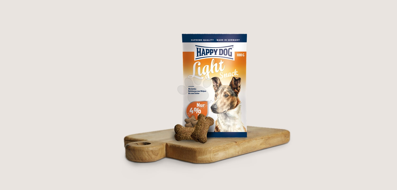 Happy Dog Supreme Light Snack - деликатесни бисквити за кучета с наднормено тегло и намалена физическа активност 100 гр.